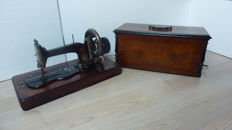 Antique Gritzner sewing machine with wooden case, Germany, ca. 1900.