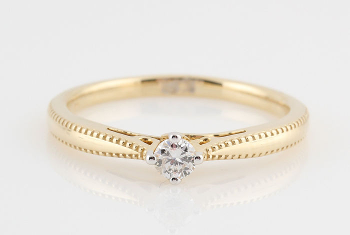 14 kt yellow gold diamond solitaire ring 0.15 ct / G-VS1 / 2.40 g / 52 / ´NEW´