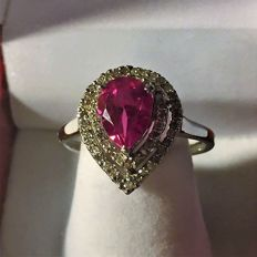 "White gold ring set with 57 diamonds of 0.35 ct and a natural pink ""Pear"" tourmaline of 1.70 ct"