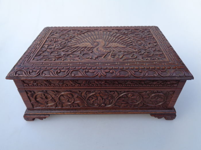 Rosewood Oriental box with carving of a peacock and floral depictions - ca. 1920