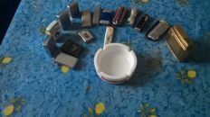 lots of 16 lighters and an ashtray