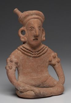 Pre-Columbian Colima seated figure holding a knife - Mexico - 19 cm
