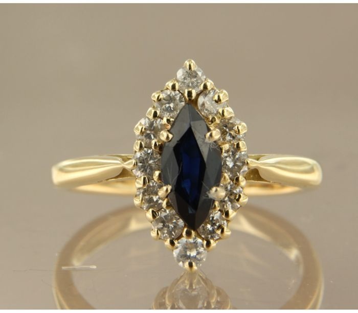 18 kt yellow gold marquise ring, set with a central, marquise shape, cut sapphire and 12 brilliant cut diamonds, approx. 0.84 ct in total