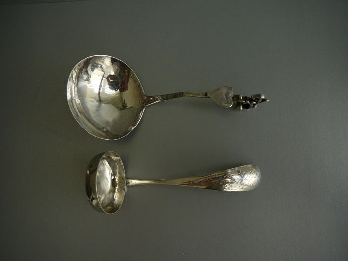 Antique silver cream spoon crowned with heart-shaped blank shield and a squirrel, Mr H Ament, Joure 1857, an antique silver sauce ladl with hook, 1868