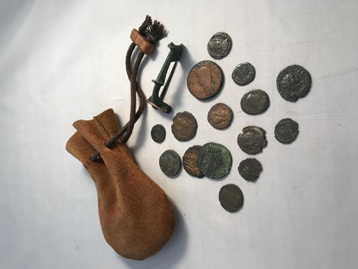 Roman Empire - lot consisting of 15 AE coins and a fibula, together with a modern leather pouch