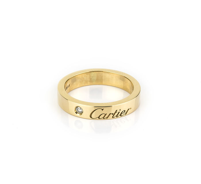 Cartier – Cocktail ring in yellow gold with brilliant cut central diamond – Size: 15 (Spain)