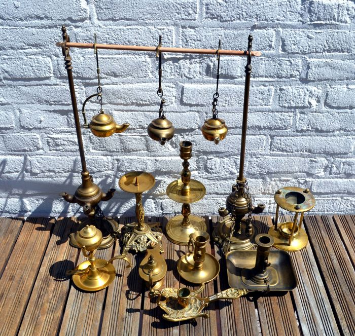 Collection of seven oil lamps and five candlesticks, second half of the 20th century
