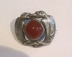 Silver brooch from Arts & Crafts period (Dragestil) with carnelian, signed by Henrik Møller (1858-1937), Trondheim, Norway.