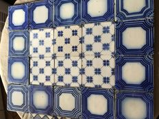 28 tiles of Desvres stamped Fourmaintraux Courquin and Fourmaintraux Hornoy, France, around 1867/1877
