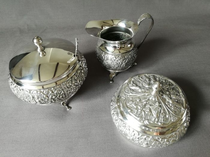 Beautifully decorated silver plated sugar bowl with sugar spoon, tea canister and cream jug by Herman Hooijkaas from 1960.