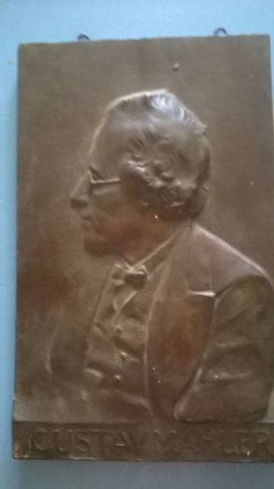 An antique ceramic plaque depicting portrait of Gustav Mahler