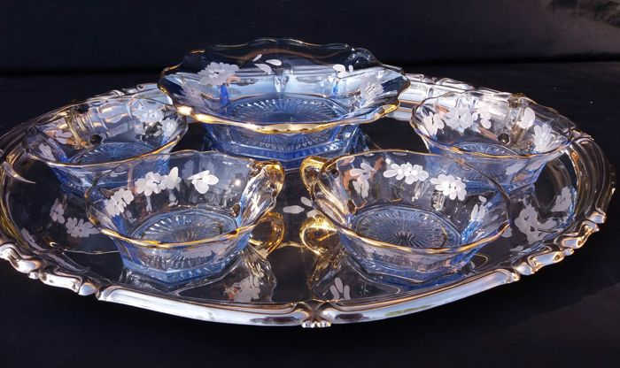 A candy bowls made of blue cut crystal with golden rims and floral decorations - France - about 1920