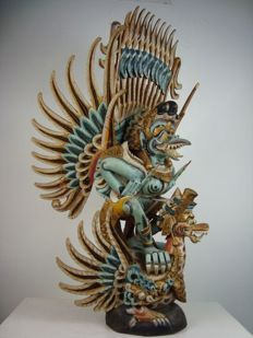 Large wooden statue of Garuda and the winged Naga – Bali – Indonesia