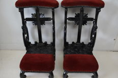2 equal richly carved and black lacquered wooden praying chairs - the Netherlands - 19th century.