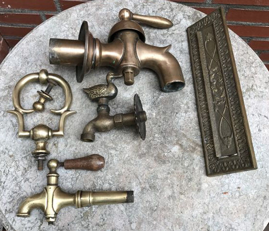 Various copper: three faucets, doorknocker and a brass letterbox frame, 1920s