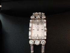 EBEL- Exquisit Watch and Diamond tennis bracelet combination in 18kt white gold and 10 ct of diamonds( F-G) IF/VVS.