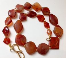 Strand of ancient carnelian trade beads, ca. 51 cm