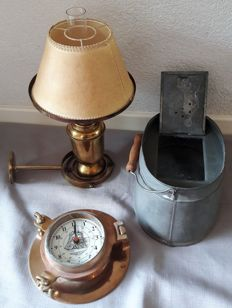 3 nice nautical objects: Quartz clock in a porthole, chum bucket, gimbal lamp
