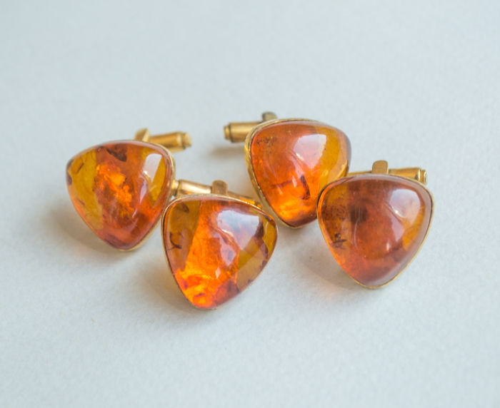 Two pair of Natural Baltic Amber cuff links with natural butterscotch, egg yolk Amber