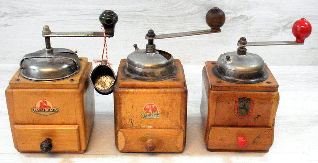 Three antique and famous brand wooden coffee grinders