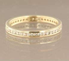 14 kt yellow gold, full eternity ring in channel setting with 45 brilliant cut diamonds, in total approx. 0.45 carat, ring size 17.25 (54)