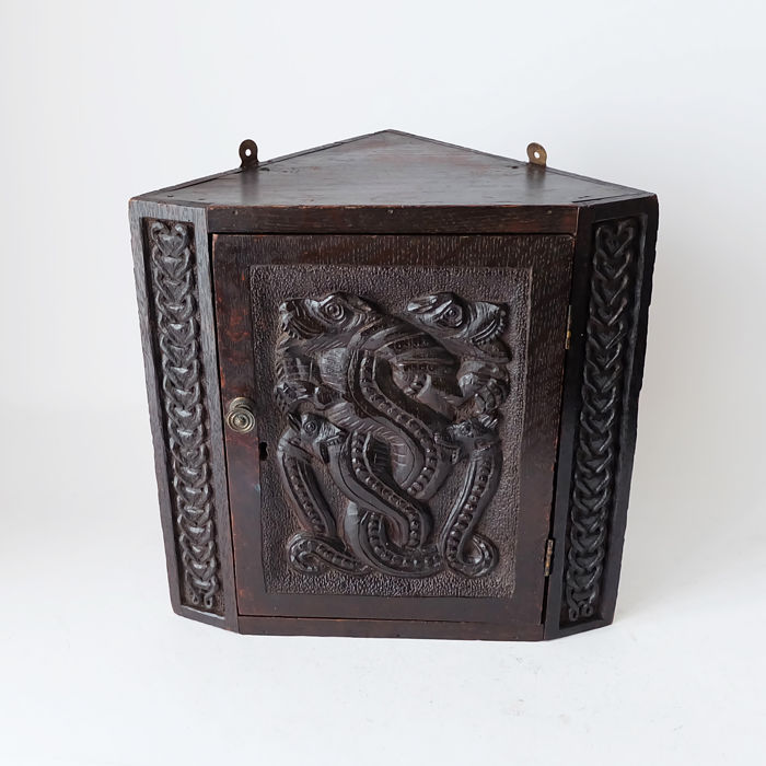 Antique corner cabinet with beautiful carved door depicting a type of  snakes and dragons - Antique Corner Cabinet With Beautiful Carved Door Depicting A Type