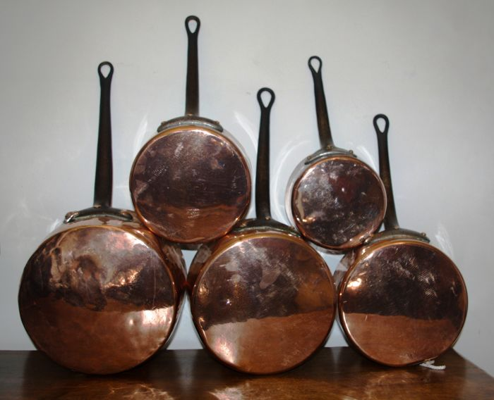 Set of 5 copper pans with cast iron handle.