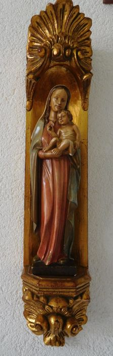 Mary statue with wall plate