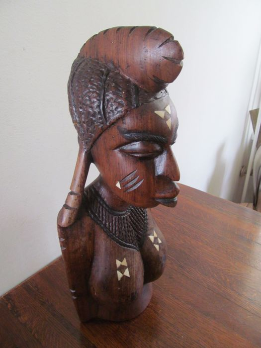 Large African antique wooden woman's bust with bone inlay