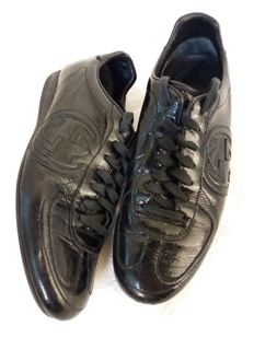 Gucci – black patent-leather trainers
