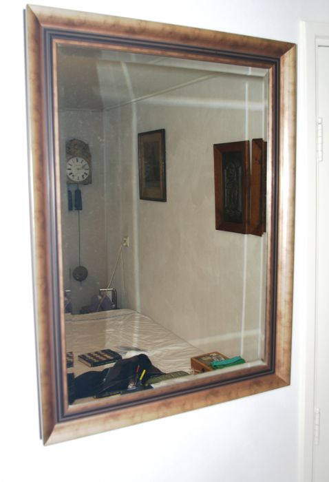 Mirror with faceted glass in gilded wooden frame
