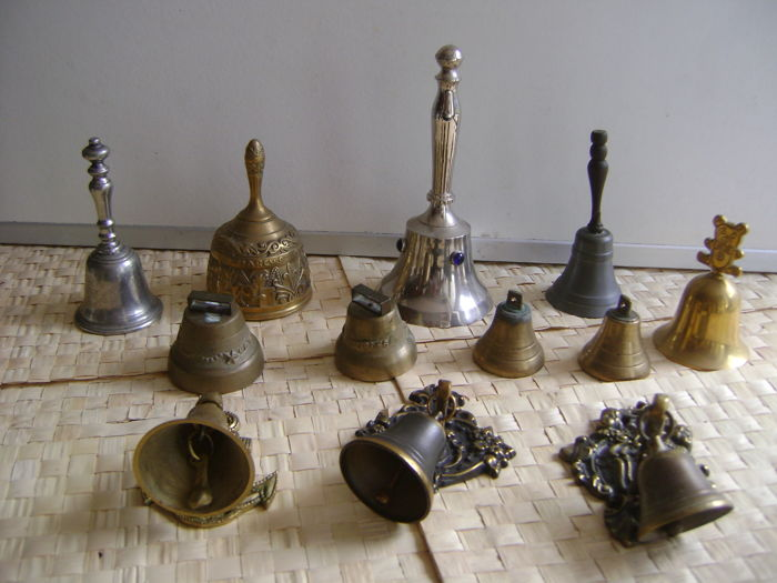 12 copper and silver plated table/wall bells.