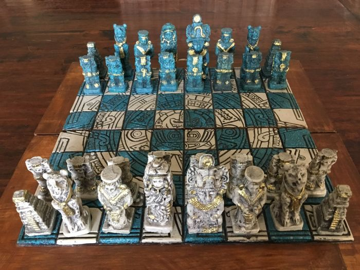 Mexican chess set with hand-carved stone Aztec pieces in folding box/board