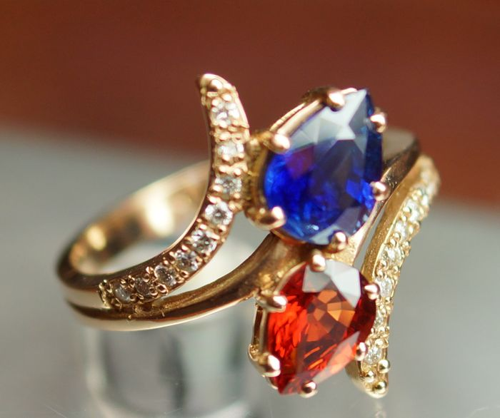 14 kt Gold Ring - 4.31 gr. with Blue Sapphire - 1.70 сt. and Orange Sapphire - 1.36 ct. - Size: 54