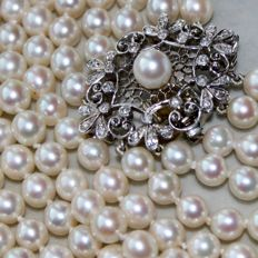 "Five-row necklace with genuine sea/salt pearls AAA. White gold 18kt./750 large clasp  ""LOTOS"" in floral form full with small diamonds G/VVS. Excellent!!!"
