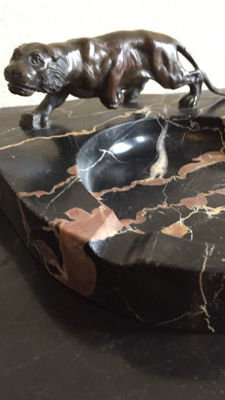 A bronze panther on a Noir Saint Laurent marble ashtray, France, first half of 20th century