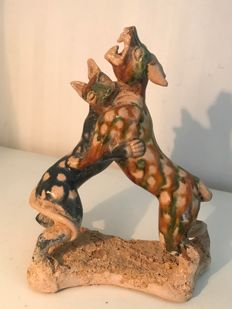 Sancai porcelain sculpture of two fighting dogs - 18 cm x 15 cm