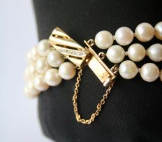 Three-row pearl bracelet with Akoya pearls, 6 – 6.5 mm and Gold clasp with Diamond, 0.10 ct.