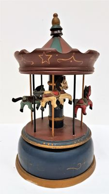 Wooden music box in the shape of a carousel
