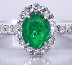 Ring with a natural, green Colombian emerald, 0.65 ct, and 30 brilliant cut diamonds.