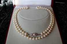 Long Akoya necklace with sea/salty AA pearls from Japanese sea and Art-Deco 18Kt Gold clasp set with a pearl in an excellent condition