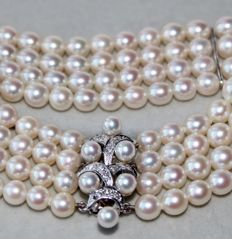 """Schoeffel"" Four-row Akoya round pearls  ø 5,2 mm. bracelet in floral form full with small diamonds ca. 0.18 ct"