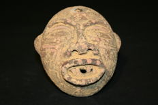 Pre-Columbian ceramic art. Men's ceremonial mask. 103 mm high.