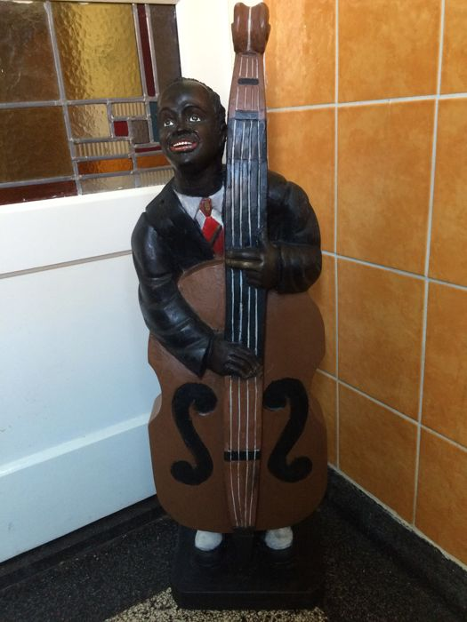 Large, very decorative, polychrome wood door stopper/sculpture of a Jazz bassist