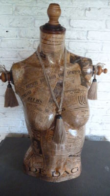 Beautiful bust of a lady lined with war newspapers