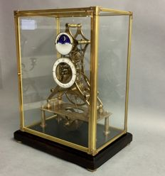 Skeleton clock with moon phase and fusee movement under glass housing– mid 20th century