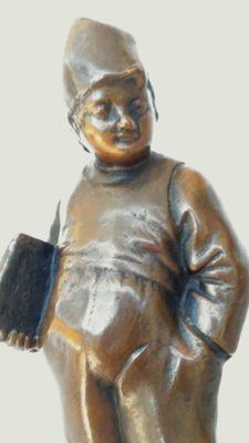 Figure of a Dutch schoolboy with typical clogs - bronze sculpture - marked 'TW'
