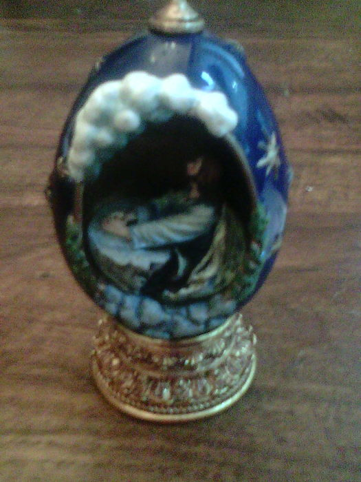 "House of Faberge - "" Agony in the Garden"" egg in hand-painted cold-cast porcelain, and set on a handsome golden cold-cast base."