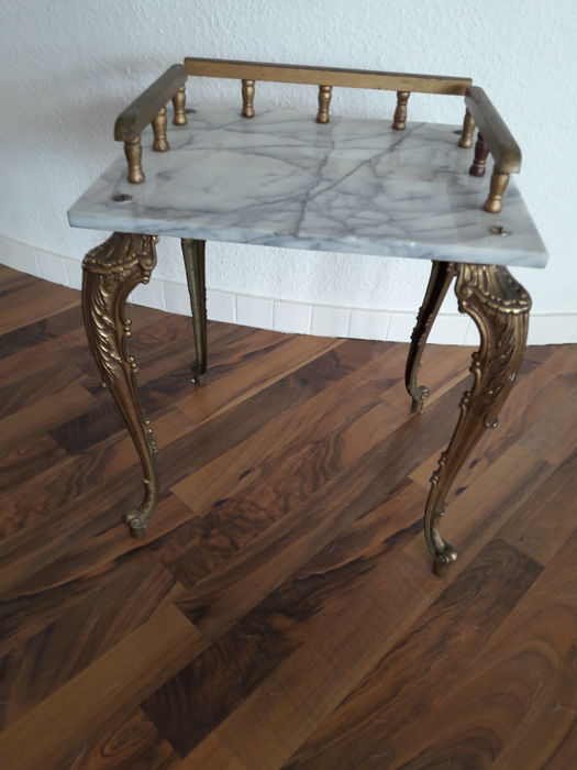 Small, antique table with marble top and brass legs