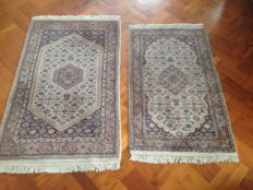 Two hand-knotted Indo-Bidjar carpets, 150 x 93 & 130 x 78 cm.